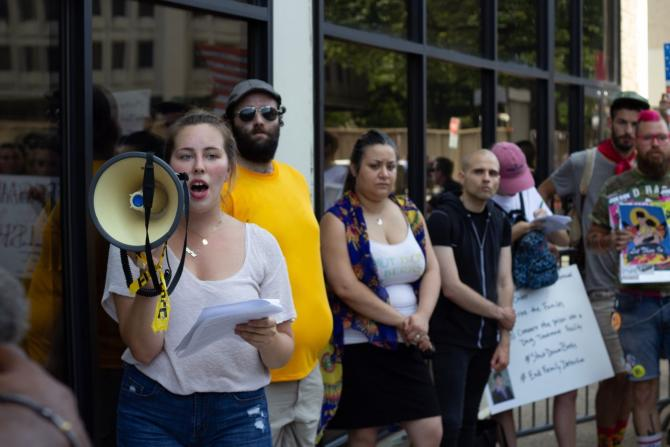 RRC student Lizzie Horne (left, with megaphone) leads a protest against border detention camps for Never Again Action in Center City on July 4, 2019.