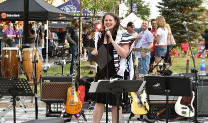 Rabbi Rachel Weiss ('09) of Evanston's Jewish Reconstructionist Congregation addresses the audience at Pride Fest in Evanston on July 25, 2019.